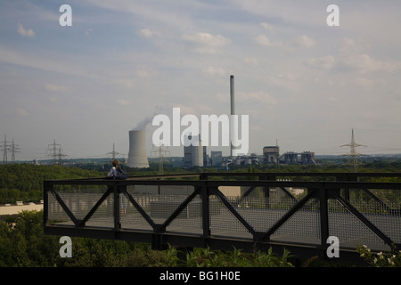 view from Halde Hoheward to chimneys of the Ruhrgebiet - Stock Photo