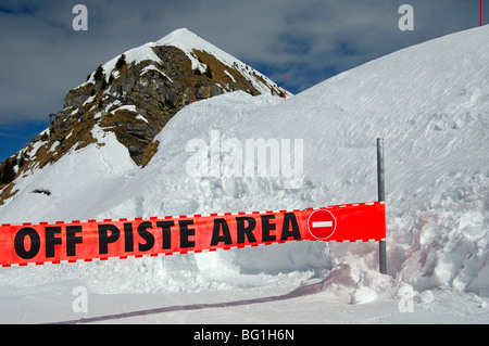 Warning sign preventing access to a closed ski-run in the skiing area Morzine Avoriaz, Haute-Savoie, France - Stock Photo