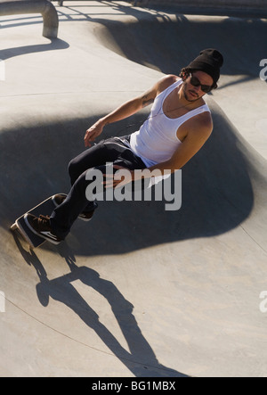Skateboarder at a skate park in Venice Beach, Los Angeles, California, United States of America - Stock Photo