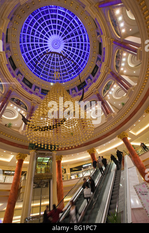 UK, England, Manchester, Trafford Centre, large indoor shopping mall decorated for Christmas, central atrium dome - Stock Photo