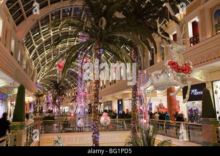 UK, England, Manchester, Trafford Centre, shopping mall decorated for Christmas flying reindeer decorations - Stock Photo