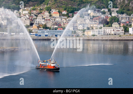 Dressed overall, with the traditional farewell display, the fireboat at Alesund, Norway, Scandinavia, Europe - Stock Photo