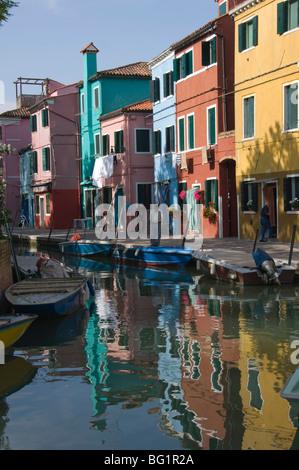 Pastel coloured houses reflected in a canal, Burano, Venetian Lagoon, Venice, Veneto, Italy, Europe - Stock Photo