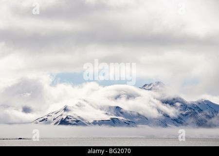 Cloud-covered mountains near Hornsund, Svalbard Islands, Arctic, Norway, Europe - Stock Photo