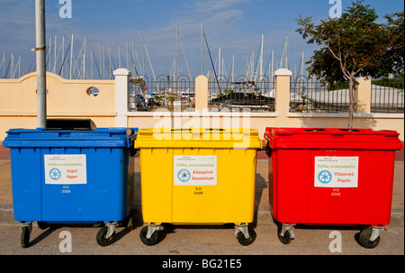 Red yellow and blue recycling bins on the Greek island of Kos - Stock Photo