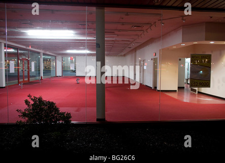 A vacant retail store front in a shopping center.  - Stock Photo