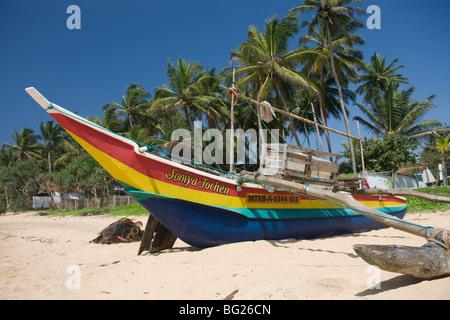 Outrigger on Hikkaduwa Beach, Sri Lanka - Stock Photo