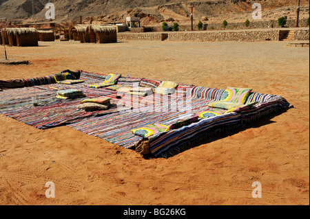 Bedouin tourist camp on the beach with carpets to rest on, Nuweiba, Sinai Egypt - Stock Photo