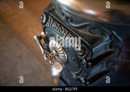 Antique cast iron wood burning stove on display in the Murakami House, Britannia Heritage Shipyard, Richmond, BC, - Stock Photo