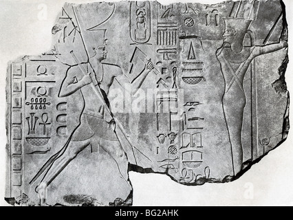 Egyptian 12th Dynasty King Senwosret I (left) performs a ritual in front of Min (right), the god of fertility. - Stock Photo