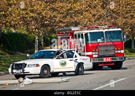 Woman driving Toyota Camry ran into lamppost & then onto an irrigation pump in Rancho Santa Margarita, fire truck - Stock Photo