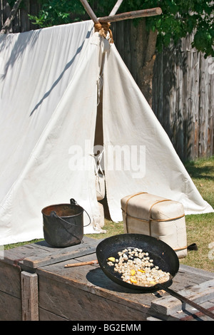 Typical pioneer meal of corn fried in bear grease at Fort William Historical Park, Thunder Bay, Ont. - Stock Photo