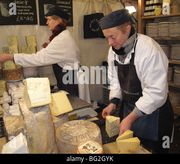 A stall selling cheese at Lincoln Christmas Market, Lincoln, Engalnd, U.K. - Stock Photo