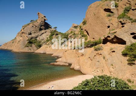 Single Sunbather on Pebble Beach at Calanque de Figuerolles, Mediterranean Coast, La Ciotat, Provence, France - Stock Photo