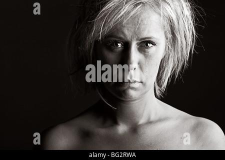 Powerful Shot of an Upset Blonde Woman - Stock Photo