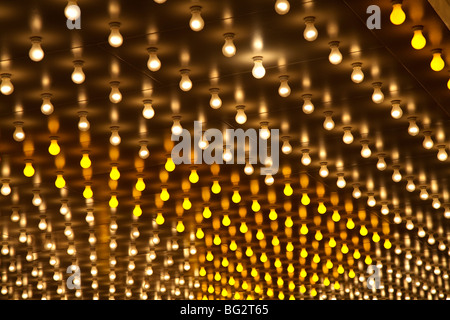 Yellow and white light bulbs underneath the foyer outside the lobby of the iconic Balaban and Katz theatre in Chicago - Stock Photo