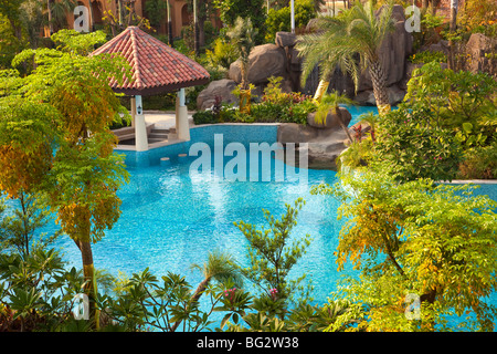 Swimming pool and trees in the garden in a new Chinese residential district - Stock Photo