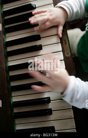 Little child playing piano . Bonn , Germany . - Stock Photo