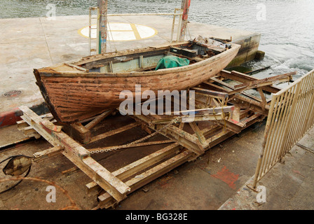 An old boat being refitted or repaired on the slipway at Chalk Bay, Cape Town - Stock Photo