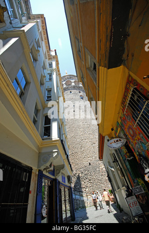 ISTANBUL, TURKEY. Looking up at the Galata Tower in the Beyoglu district of the city. 2009. - Stock Photo