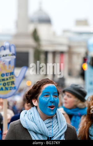 Female demonstrator with blue face, on the Climate Change march in London 2009. - Stock Photo