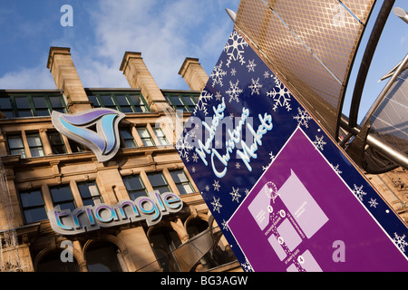 UK, England, Manchester, Cathedral Street, Christmas Markets advertising sign outside the Triangle - Stock Photo