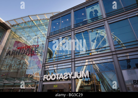 UK, England, Manchester, Cathedral Street, Manchester Wheel, reflected in Arndale Centre entrance - Stock Photo
