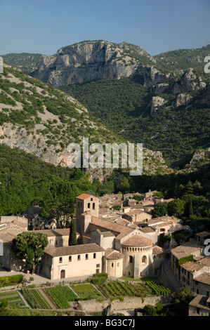 View over Abbey Church of Saint-Guilhem-le-Désert and Village in Verdus Gorge, Hérault, Languedoc Roussillon, southern - Stock Photo
