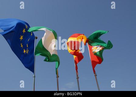 flags on the Torre de la Vela,  The Alcazaba, the Alhambra, Granada, Andausia, Spain - Stock Photo