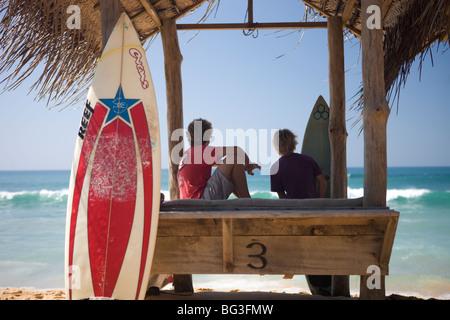 Surfers on Hikkaduwa Beach, Sri Lanka - Stock Photo