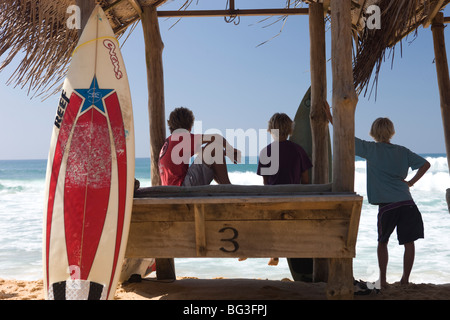 Surfers on Hikkaduwa Beach, Sri Lanka - Stock Photo