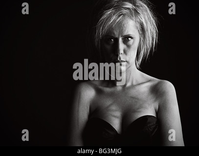 Powerful Low Key Shot of a Distressed and Scratched Blonde Woman - Stock Photo