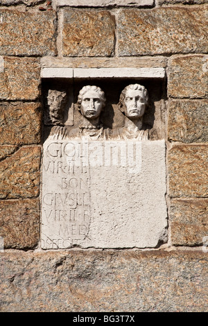 Roman tombstones, from first century AD, in Archi di Porta Nuova, one of the surviving gates of the medieval walls - Stock Photo