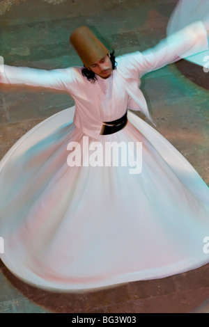 The Mevlevi, (Whirling Dervishes) performing the Sema (ceremony), Istanbul, Turkey, Europe - Stock Photo