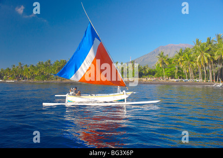 Local fisherman on a traditional outrigger boat, Bali, Indonesia, Southeast Asia, Asia - Stock Photo