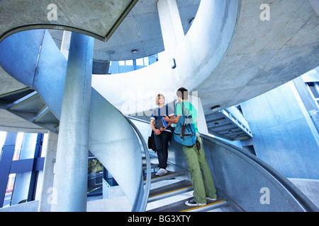 University students on staircase - Stock Photo