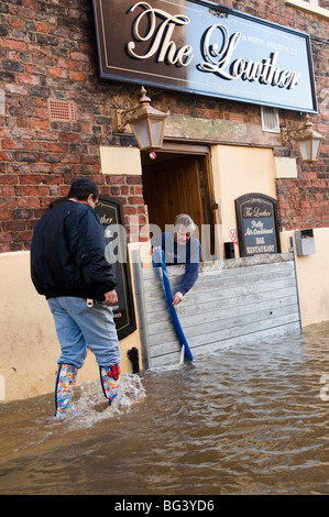 pub in york uk being pumped out of flood water after the river ouse burst its banks - Stock Photo