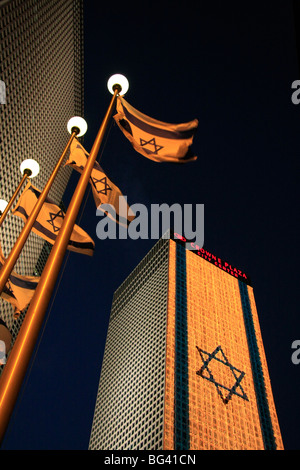Israel, Tel Aviv, an illuminated Israeli flag at Azrieli Center on Independence day - Stock Photo