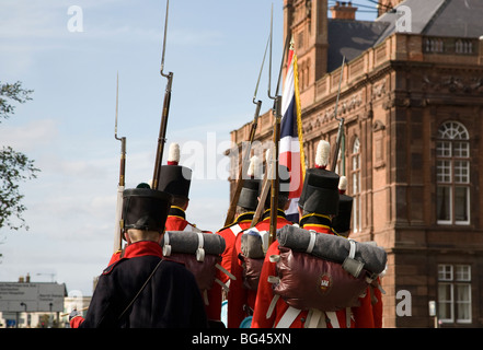 East Norfolk Militia march past Great Yarmouth Town Hall during the town's annual Maritime Festival - Stock Photo