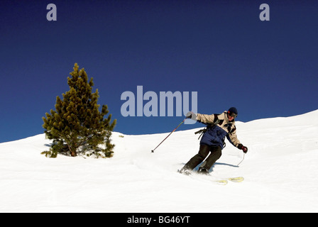Skier on off piste run at Meribel in the Three Valleys, the world's largest complete skiing area, western French - Stock Photo