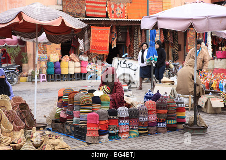 Market trader on hat stall, Marrakech, Morocco, North Africa, Africa - Stock Photo
