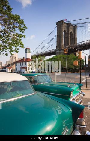 Two 1950's cars parked near the Brooklyn Bridge at Fulton Ferry Landing, Brooklyn, New York City, New York, USA - Stock Photo