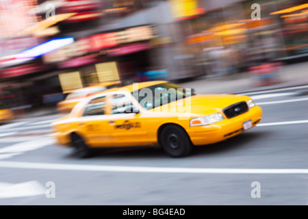 Taxi cabs in Times Square, Midtown, Manhattan, New York City, New York, United States of America, North America - Stock Photo