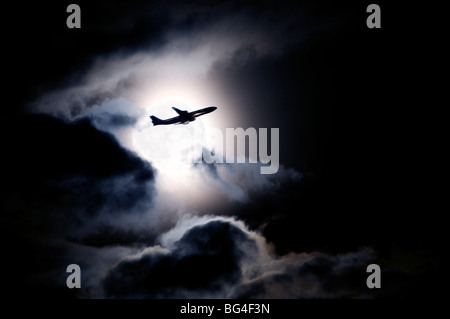 Aircraft taking off from Heathrow passing in front of full moon, London, England, United Kingdom, Europe - Stock Photo