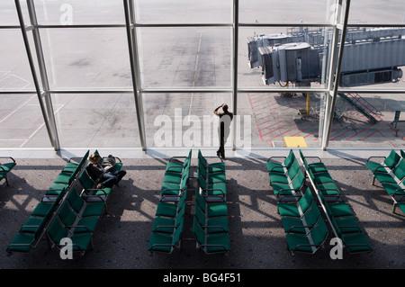 Man wan waiting at airport gate, Chek Lap Kok Airport, Hong Kong, China, Asia - Stock Photo