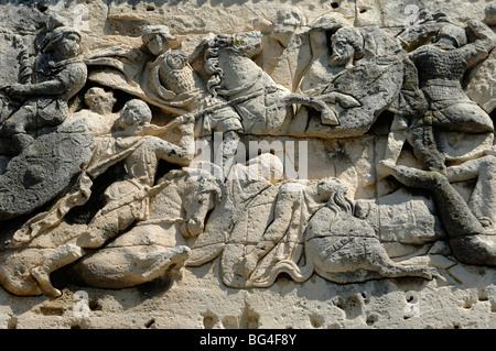 Roman & Gallic Soldiers in Battle Scene on Roman Arc de Triomphe or Triumphal Arch, Orange, Provence, France - Stock Photo