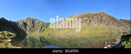 Llyn Cau, a glacial corrie lake, on a still, clear morning in September - with Cadair Idris behind - Stock Photo