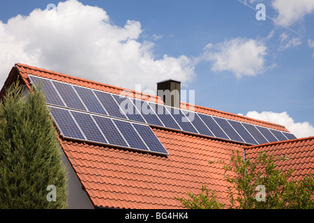Photovoltaic solar panels on a house roof on a sunny day. Bavaria, Germany, Europe. - Stock Photo