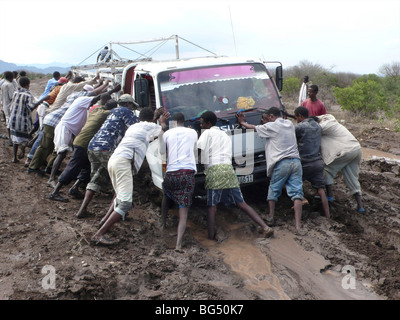 The roads are bad in Ethiopia and all the cars get stuck in the mud. - Stock Photo
