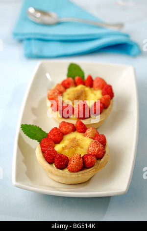 Strawberry tartlets. Recipe available. - Stock Photo
